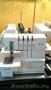 Плоскошовная швейная машинка Merrylock 095